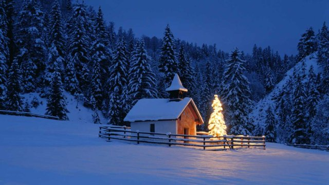 Chapel with Christmas tree in the evening --- Image by © Fridmar Damm/Corbis